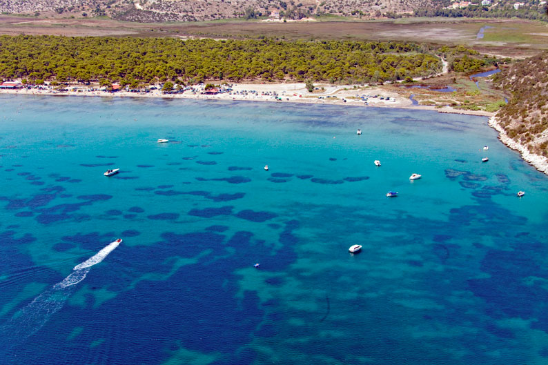 Dive in to the turquoise colored waters at Schinias Beach
