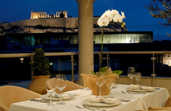 Enjoy a fabulous Mediterranean dinner beneath the light of Greek civilization at the Acropolis Museum of Athens.