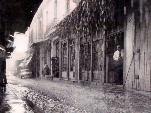 Taken in 1960 during a sudden downpour on Pandrossou Street.