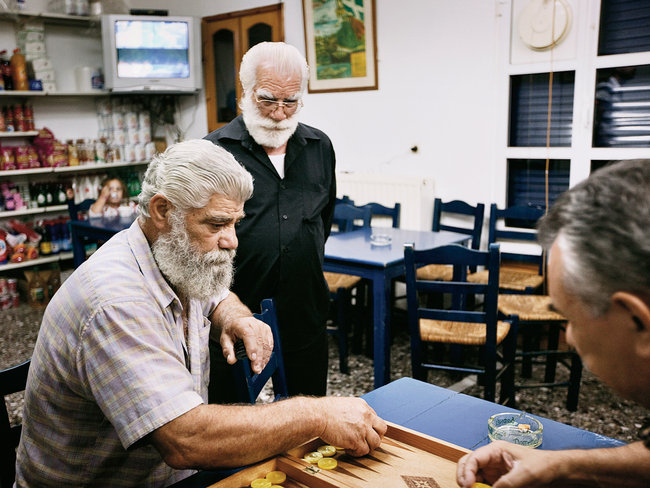 A game of backgammon at the village of Ikaria where people reach well over a hundred years old.