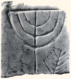 A menorah engraved in marble stone found at the site of the ancient synagogue in Athens