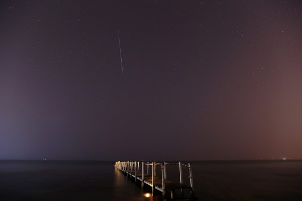 A long-exposure photo shows a meteor burning up in the atmosphere over a beach in Anavissos, Greece WP