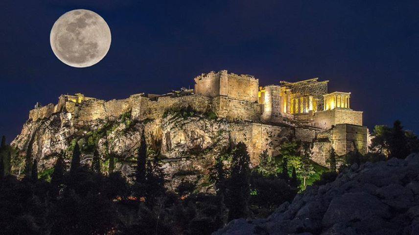 August Moon Rising Over The Sacred Rock In Athens