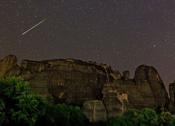 Two bright meteors flashing through this night skyscape over the World Heritage Site of Meteora