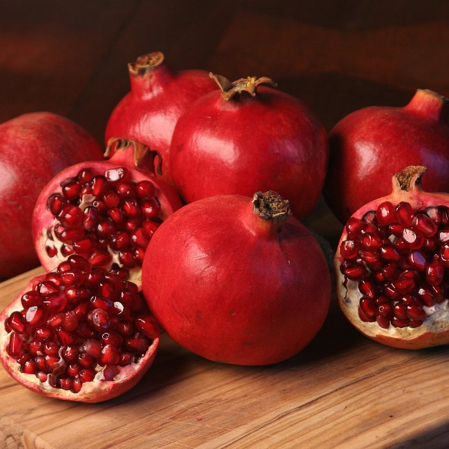 The Greeks smash the pomegranates in front of their doorstep right after the coming of the New Year.!