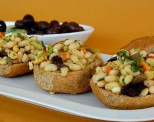Rusks with legumes and olives