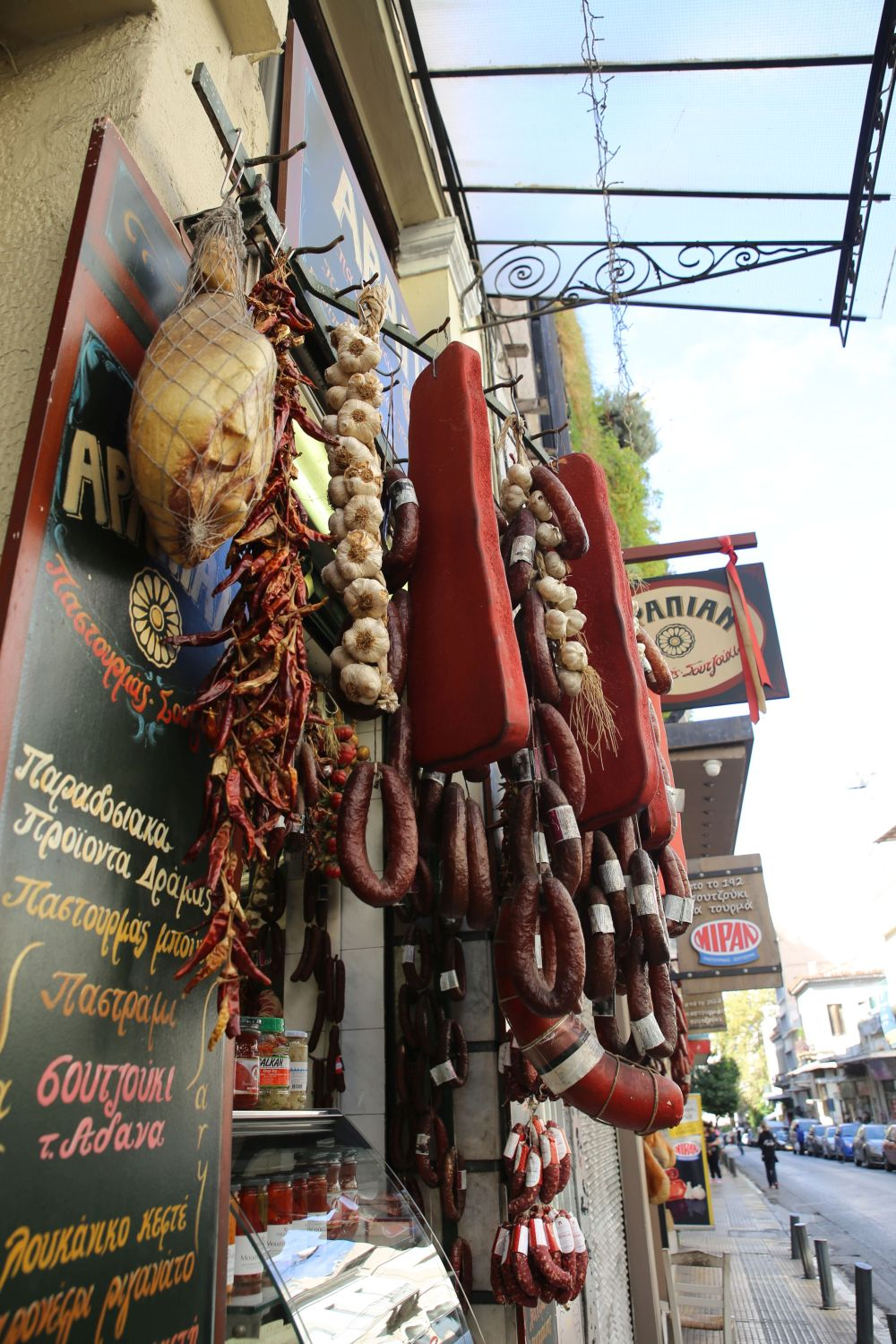 Athens food tour: Traditional food shop with curated meat
