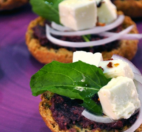 Rusks with olive spread, cheese and basilicum